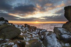 Stunning Winter sunset landscape from mountains looking over sno Stock Images