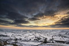 Stunning Winter sunset over snow covered Winter landscape in Pea Stock Image