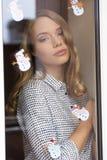 Stunning woman behind window pane Royalty Free Stock Image