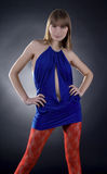 Stunning woman in blue dress on black background Royalty Free Stock Images