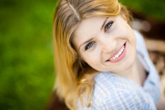 Stunning woman looks back at the camera with a smile Royalty Free Stock Image