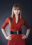 Stunning woman in red dress on black background Stock Image