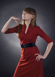 Stunning woman in red dress on black background Royalty Free Stock Photo