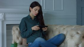 Stunning woman resting with digital tablet at home stock video footage