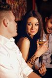 Stunning Woman with Male Friends at the Bar Royalty Free Stock Photo