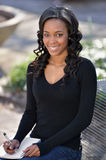Stunning young African American female student on campus Royalty Free Stock Image