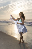Stunning young African-American woman on beach at sunrise Royalty Free Stock Photos