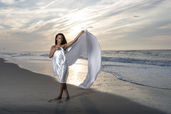 Stunning young African-American woman on beach at sunrise Royalty Free Stock Photography