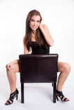 Stunning Young Beautiful Barefoot Woman Straddles Black Leather Stock Photos