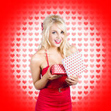 Stunning young blond beauty holding heart present Royalty Free Stock Photo