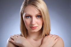 Stunning young blonde girl with blue eyes Royalty Free Stock Images