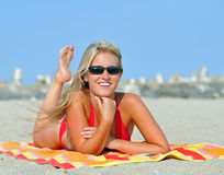 Stunning young blonde woman on beach in bikini Stock Photography