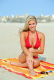 Stunning young blonde woman on beach in bikini Stock Images