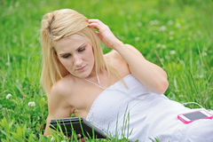 Stunning young blonde woman in field of clover Stock Photos
