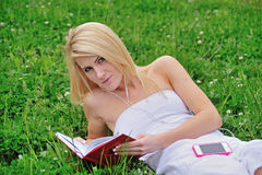 Stunning young blonde woman in field of clover Royalty Free Stock Photos