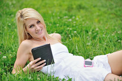 Stunning young blonde woman in field of clover Royalty Free Stock Images