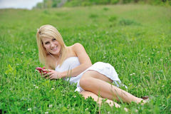 Stunning young blonde woman in field of clover Stock Photo