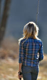 Stunning young blonde woman fishing Stock Photo