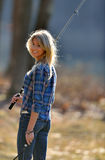 Stunning young blonde woman fishing Royalty Free Stock Image