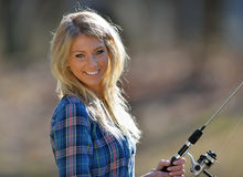 Stunning young blonde woman fishing Royalty Free Stock Photography