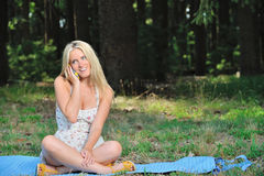 Stunning young blonde woman in sundress with cell phone Stock Photos