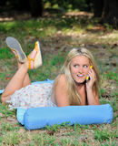 Stunning young blonde woman in sundress with cell phone Stock Photography