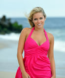 Stunning young blonde woman walking on the beach Stock Photo