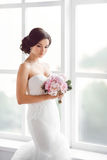 Stunning young bride holding bouquet Stock Photos