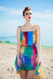 Stunning young Caucasian woman walking on a beach Royalty Free Stock Photography
