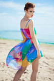 Stunning young Caucasian woman walking on a beach Stock Photos