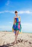 Stunning young Caucasian woman walking on a beach Stock Photo