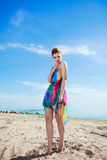 Stunning young Caucasian woman walking on a beach Stock Photography