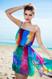 Stunning young Caucasian woman walking on a beach Royalty Free Stock Image