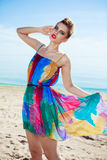 Stunning young Caucasian woman walking on a beach Stock Images