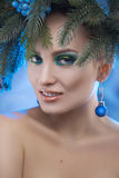 Stunning young girl with xmas tree-wreath on head looking at cam Royalty Free Stock Photos
