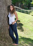Stunning young Hispanic woman in jeans and tank top Royalty Free Stock Photos