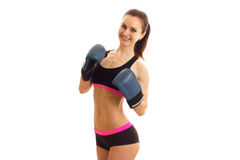 Stunning young sportswoman smiles for the camera in boxing gloves. Is isolated on a white background Stock Images