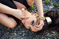Stunning young woman with beautiful dark hair lying Stock Photos