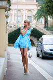 Stunning young woman in beautiful short blue dress in Monte Carlo Stock Images