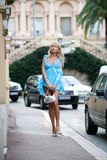 Stunning young woman in beautiful short blue dress in Monte Carlo Stock Photos