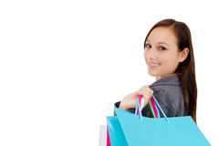 Stunning young woman carrying shopping bags Royalty Free Stock Images