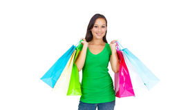Stunning young woman carrying shopping bags Royalty Free Stock Photography
