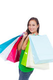 Stunning young woman carrying shopping bags Royalty Free Stock Image