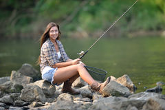 Stunning young woman fishing Royalty Free Stock Photography