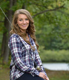 Stunning young woman fishing Royalty Free Stock Images