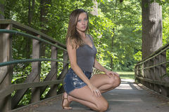 Stunning young woman poses in woods Stock Photos