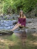 Stunning young woman poses in woods Stock Photography