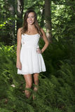 Stunning young woman poses in woods Royalty Free Stock Image