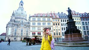 Stunning Young woman showing girlfriend in videocall neighborhood of european city on cool afternoon outdoors Dresden. Elegant girl with smile on face talking stock footage