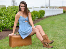 Stunning young woman in sundress with suitcase Stock Photography
